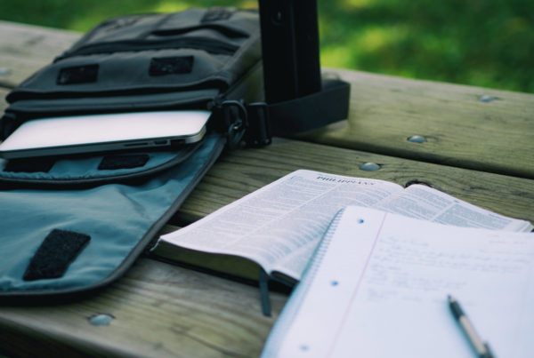 Background image of a notepad and Bible for your work matters article